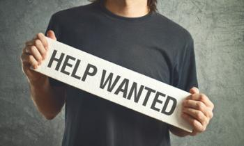 "Guy holding a ""help wanted"" sign"