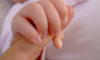 Baby grasping finger