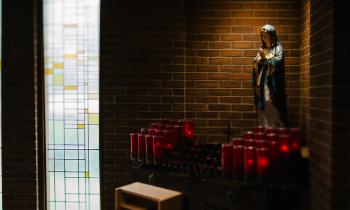 Our Lady statue with candles