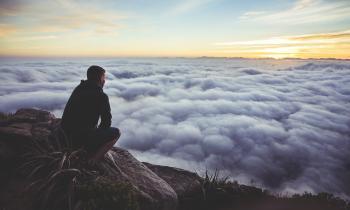man contemplating clouds make God priority #1