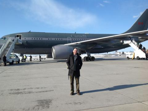 Josh about to board a government jet