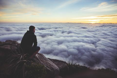 man contemplating clouds make God priority #1