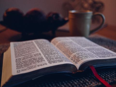 A Bible and a coffee together